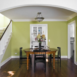 Photo of a classic dining room in Chicago with green walls.