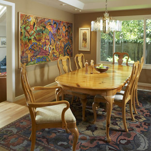 Enclosed dining room - traditional medium tone wood floor enclosed dining room idea in San Francisco with brown walls