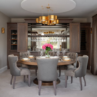 Photo of a medium sized classic dining room in London with grey walls, carpet, no fireplace and grey floors.