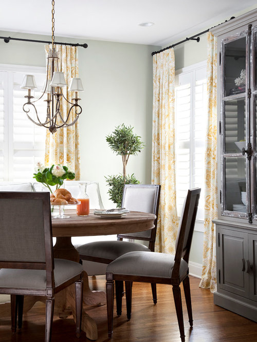 traditional dining room idea in austin with white walls and medium