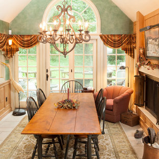 Inspiration for a mid-sized country ceramic floor enclosed dining room remodel in New York with green walls, a standard fireplace and a metal fireplace