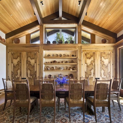 Mid-sized mountain style dark wood floor enclosed dining room photo in New York with white walls