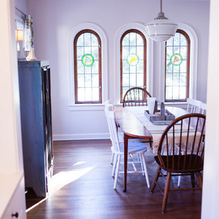 Inspiration for a country dining room in Indianapolis with medium hardwood floors.