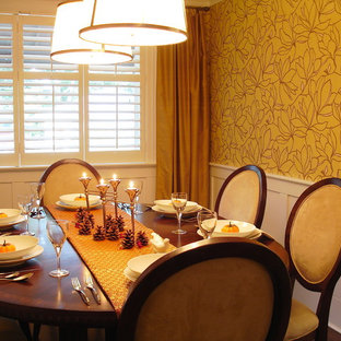 Example of a classic dining room design in Toronto with yellow walls