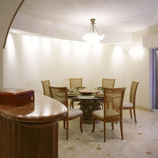 Mediterranean Dining Room by Jerry Jacobs Design, Inc.