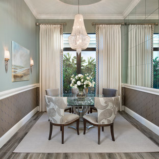 Example of a transitional enclosed dining room design in Tampa with green walls