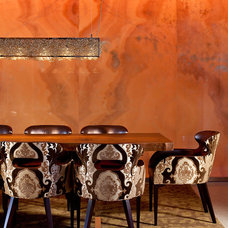 Eclectic Dining Room by KuDa Photography