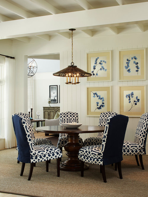 midsized traditional enclosed dining room idea in miami with white walls