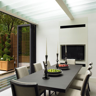 Photo of a medium sized contemporary dining room in London with white walls.