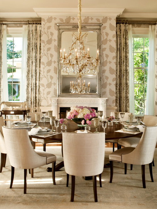 Inspiration for a transitional carpeted dining room remodel in orlando with a standard fireplace and beige