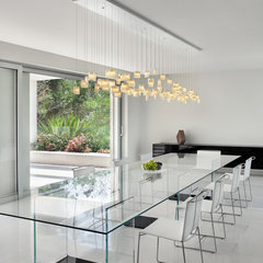 modern dining room by Light In Art
