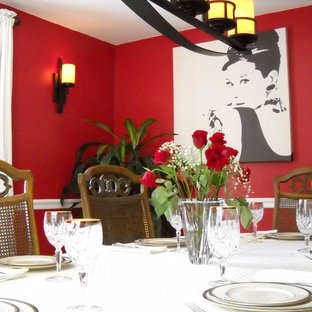 Eclectic enclosed dining room photo in Boston with red walls