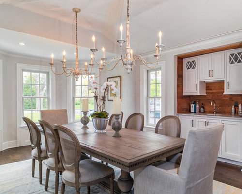 Decorations For Dining Room Walls dining room decoration tips decoration ideas Example Of A Classic Dark Wood Floor Dining Room Design In New York With Gray Walls