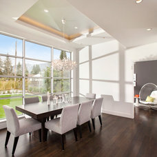 Modern Dining Room by Meister Construction Ltd