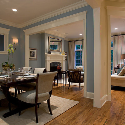 Example of a classic brown floor great room design in Chicago with blue walls