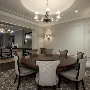 Inspiration for a contemporary dark wood floor dining room remodel in Chicago with gray walls