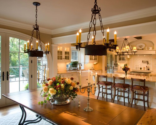 Example Of A Classic Kitchen Dining Combo Design In Minneapolis With Medium Tone Wood Floors