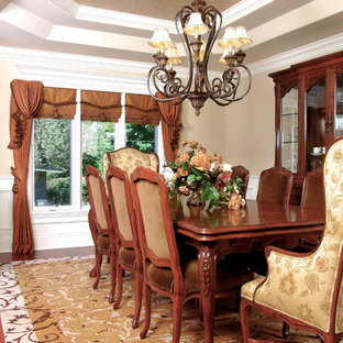 Enclosed dining room - large traditional dark wood floor enclosed dining room idea in Chicago with beige walls