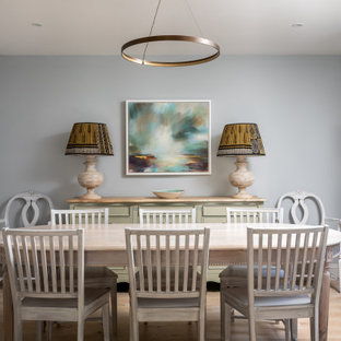 Medium sized nautical enclosed dining room in Gloucestershire with grey walls, light hardwood flooring and brown floors.