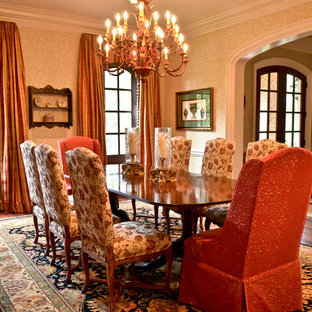 Inspiration for a large timeless medium tone wood floor enclosed dining room remodel in Atlanta with yellow walls and no fireplace