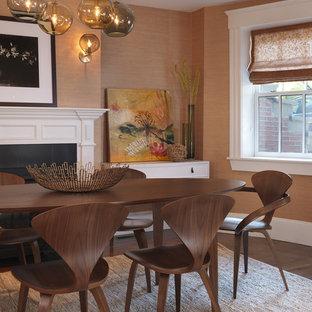 Идея дизайна: столовая в стиле современная классика с оранжевыми стенами, темным паркетным полом, стандартным камином и фасадом камина из дерева