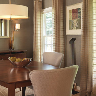 Example of a transitional medium tone wood floor dining room design in Boston with brown walls