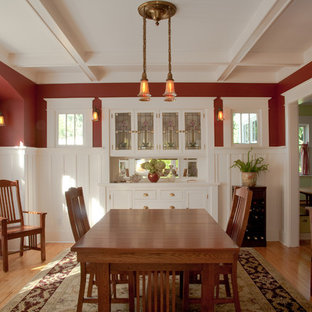 Enclosed dining room - large craftsman light wood floor enclosed dining room idea in Seattle with red walls and no fireplace