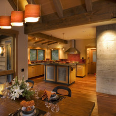 Rustic Dining Room by Ryan Group Architects