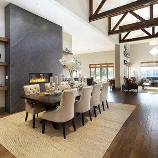 Idéer för en stor medelhavsstil matplats med öppen planlösning, med vita väggar, mörkt trägolv, en bred öppen spis och en spiselkrans i trä