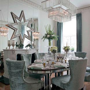 Ispirazione per una grande sala da pranzo contemporanea con pareti grigie, parquet scuro, camino classico e cornice del camino in pietra