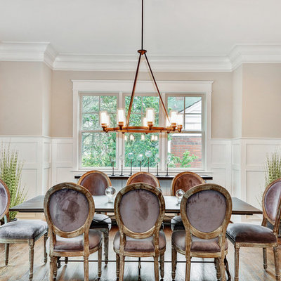 Example of a mid-sized transitional dark wood floor and brown floor enclosed dining room design in DC Metro with beige walls and no fireplace