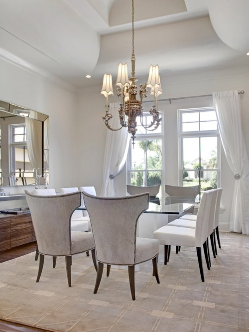 Example Of A Transitional Dining Room Design In Orlando With White Walls And Dark Hardwood Floors