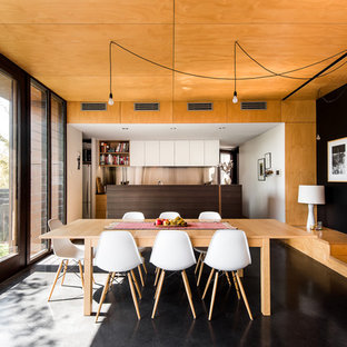 Mid-sized trendy concrete floor kitchen/dining room combo photo in Perth with white walls