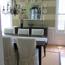 Eclectic Dining Room by Two Story Cottage