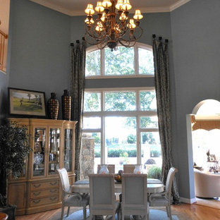 Inspiration for a huge timeless light wood floor enclosed dining room remodel in DC Metro with blue walls