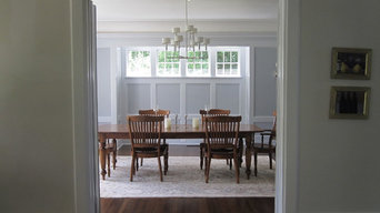 Dining room with painted wood paneling