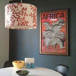 Eclectic dining room photo in San Francisco with black walls