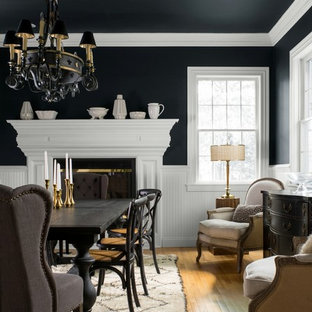 Dining room - traditional medium tone wood floor and brown floor dining room idea in New York with black walls