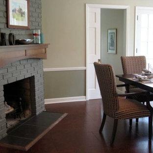 Неиссякаемый источник вдохновения для домашнего уюта: большая отдельная столовая в стиле современная классика с зелеными стенами, пробковым полом, стандартным камином, фасадом камина из кирпича и коричневым полом
