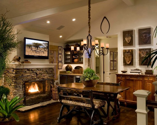 Inspiration For A Mediterranean Dining Room Remodel In Orange County With Stone Fireplace