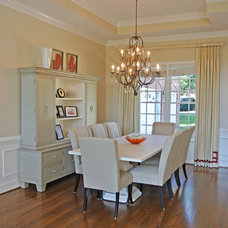 Traditional Dining Room by June DeLugas Interiors