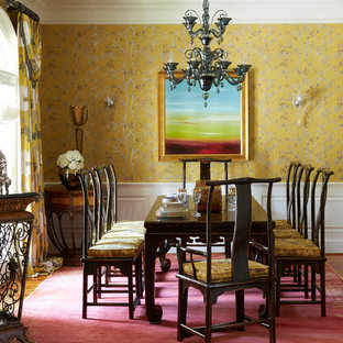 Design ideas for a dining room in Chicago with yellow walls, medium hardwood floors and brown floor.