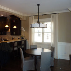 Traditional Dining Room by Window Dressings
