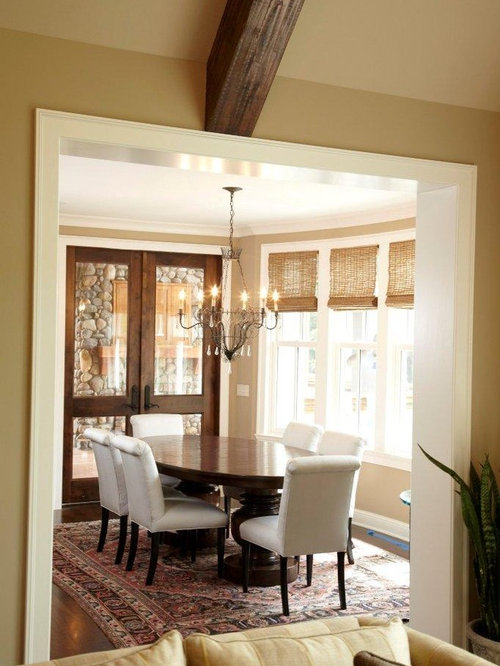 elegant dining room photo in minneapolis with beige walls and dark