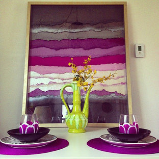 This is an example of a midcentury dining room in Denver.