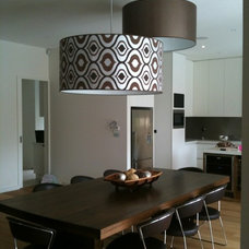 Contemporary Dining Room by TOFFI Furnishings