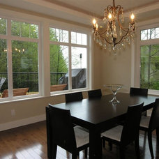 Contemporary Dining Room by Werner Construction Ltd.
