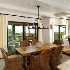 Beach Style Dining Room by R.M. Buck Builders