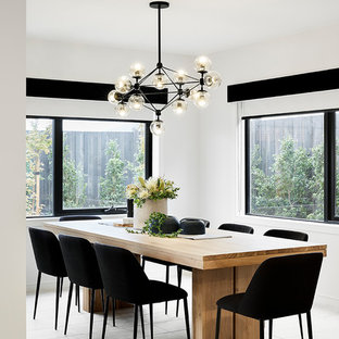 Contemporary separate dining room in Melbourne with white walls, no fireplace and beige floor.