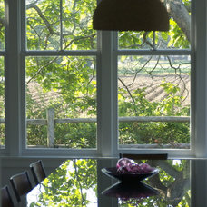 Modern Dining Room Divided light windows frame the farm from the dining room.
